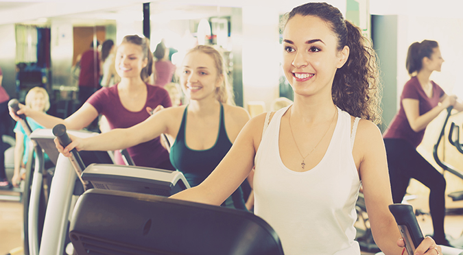 gym members in fitness club with gym sales software