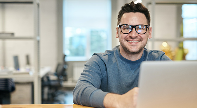 gym owner researching marketing strategies for gyms and gym lead generation ideas